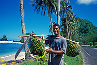 Man carries baskets. Failolo, Tutuila, American Samoa