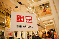End of the line for check-out at the grand opening of the Uniqlo Flagship store on Fifth Avenue in New York on Friday, October 14, 2011.  The store is a staggering 89,000 square feet on multiple levels and is Fast Retailing's second store in the United States with a third opening next week in the Herald Square shopping district. The largest store on Fifth Avenue filled to the brim with affordable clothing it competes with stalwarts such as the Gap and Zara which are in the immediate proximity. Fast Retailing plans on opening 200 to 300 stores worldwide until 2020 and currently has 1000 stores. (© Richard B. Levine)