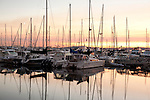 Sunset Elliott Bay Marina with boats moored at dock with crescent moon and reflections Seattle Washington State USA