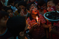 Gaza city, June 2, 2010.People of Gaza demonstrate in hommage of the 9 Turkish victims of the Israeli navy assault on the international activist flotilla..They carry a symbolic coffin that they put to the sea as well as flowers in the form of a small boat.