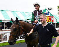 Winner of The Shadwell Stud Racing Excellence Apprentice Handicap (Div 1), Intimately ridden by Pierre-Louis Jamin is led into the winners enclosure during Afternoon Racing at Salisbury Racecourse on 18th May 2017
