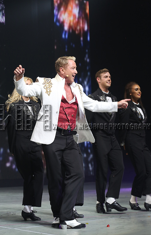 Michael Flatley with the cast onstage during the curtain call for the Broadway Opening and dedut of 'Lord of the Dance: Dangerous Games' at The Lyric Theatre on November 10, 2015 in New York City.