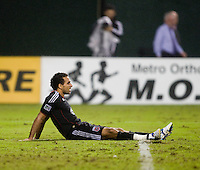 Dwayne De Rosario (7) of D.C. United sits on the field exhausted during the game at RFK Stadium in Washington, D.C. D.C. United tied the Portland Timbers, 1-1.