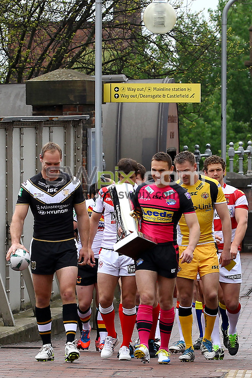 PICTURE BY ALEX WHITEHEAD/SWPIX.COM - Rugby League - Super League - Magic Weekend Preview - Deansgate Tram Stop, Manchester, England - 21/05/13 - Captains for the 14 Super League clubs head towards the Deansgate Tram platform in Manchester on their way to the Etihad Stadium for the Magic Weekend.