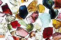 ASSORTMENT OF GEMSTONES<br /> Uncut<br /> aquamarine (light blue),  ruby &amp; garnet (red), sapphire &amp; tanzanite (blue), emerald (green), tourmaline(pink), citrine (brown) ,amethyst (purple)