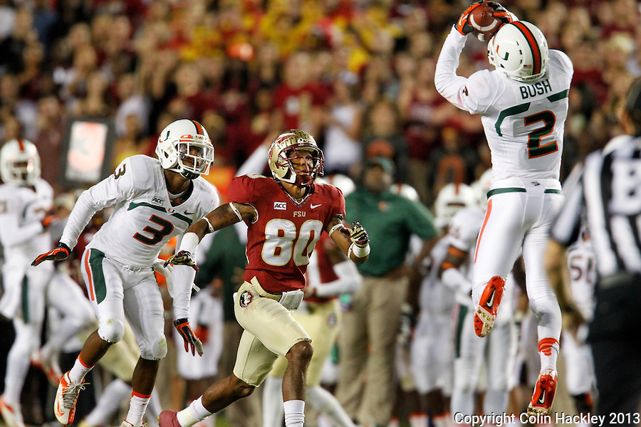 TALLAHASSEE, FL 11/2/13-FSU-MIAMI110213CH-Florida State's Rashad Greene watches as Miami's Deon Bush intercepts a Jameis Winston pass in front of him during first half action Saturday at Doak Campbell Stadium in Tallahassee. <br /> COLIN HACKLEY PHOTO