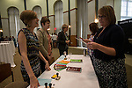 Carly Cecil, left, and Breanna Sisler, center, explain to Elizabeth Jones, right, the goal of the Ohio Gaurantee activity that took place in Walter Hall Rotunda on Wednesday, September 10, 2014. Photo by Katelyn Vancouver