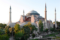 General view of Hagia Sophia, 532-37, by Isidore of Miletus and Anthemius of Tralles, Istanbul, Turkey, pictured on May 21, 2011, at sunset. Hagia Sophia, The Church of the Holy Wisdom, has been a  Byzantine church and an Ottoman mosque and is now a museum. The current building, the third on the site, commissioned by Emperor Justinian I, is a very fine example of Byzantine architecture. The historical areas of the city were declared a UNECSO World Heritage Site in 1985. Picture by Manuel Cohen.