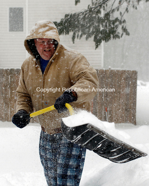 Middlebury, CT- 04 February 2014-020214CM11-  Mark Hanks of Middlebury clears a path along his sidewalk during a winter storm in Middlebury on Thursday.   Christopher Massa Republican-American