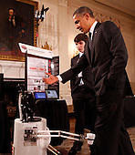 United States President Barack Obama speaks with Benjamin Hylak of West Grove, Pennsylvania, who built an interactive robot, while touring student science fair projects on exhibt at the White House in Washington, D.C. on February 7, 2012.  Obama hosted the second White House Science Fair celebrating the student winners of science, technology, engineering and math (STEM) competitions from across the country. .Credit: Molly Riley / Pool via CNP