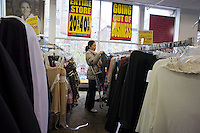 Liquidation sales of the combination Syms and Filene's Basement stores in the Upper West Side neighborhood of  in New York on Sunday, November 27, 2001. Syms Corp. and its affiliate Filene's Basement are under bankruptcy protection and are liquidating all their stock as the businesses are shut down. The 25 Syms and the 21 Filene's Basement stores are set to close in January 2012.  (© Richard B. Levine)