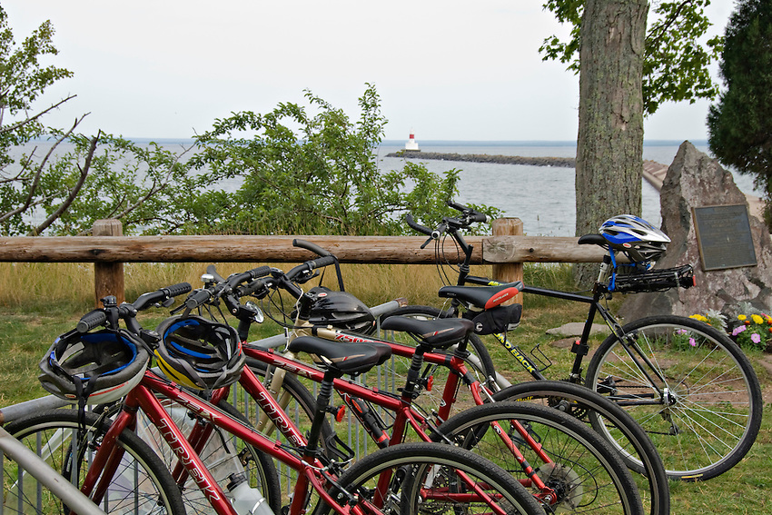 Bicycles and Upper Harbor Breakwater Light at Presque Isle Park in Marquette Michigan.