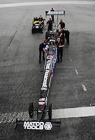 Jan. 17, 2012; Jupiter, FL, USA: Crew members push the car of NHRA top fuel dragster driver Antron Brown during testing at the PRO Winter Warmup at Palm Beach International Raceway. Mandatory Credit: Mark J. Rebilas-