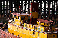 The Duluth Missabi and Iron Range railroad tugboat Edna G on display in Two Harbors, Minnesota. Built in 1896, the tugboat served Two Harbors, with the exception of being pressed into government service for two years during World War I. In 1974 she was designated a National Historic Site. She was fully restored in 1994. The Edna G was the last coal-fired, steam-engine tug in service on the lakes when she was retired in 1981. The tug is now owned and displayed by the Lake County Historical Society.
