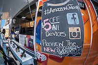 The Amazon On Tour truck, outfitted with Kindles, parks at a street fair near Union Square in New York on Saturday, November 8, 2014. The brick and mortar retail truck sold the line of Amazon Kindle products as well as previewing the new Kindle Voyage e-reader, offering a $5 discount.   (© Richard B. Levine)
