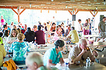 Watertown, CT- 18 May 2017-051817CM04-  Supporters pack a pavilion during the annual Greater Waterbury Campership Fund picnic at Camp Mataucha in Watertown on Thursday. The fundraiser featured a myriad of pizza options from  Big Green Pizza Truck out of New Haven, music from the Holy Cross students  with proceeds allowing children to go to summer camp.    Christopher Massa Republican-American
