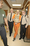 Escorted by Neshoba County  deputies, accused Klu Klux Klanman and murder Edgar ray Killen center, is lead into court in handcuffs and bullet proof vest Wed jan 12,2005 in Philadelphia Ms. Circuit  court judge Marcus Gordon, ordered a $250,000 bond and set a court date for March 28,2005.(Photo/Suzi Altman)