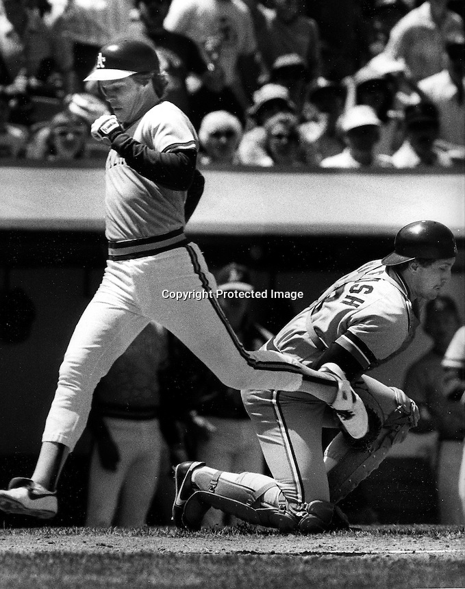 A's Donnie Hill scores as catcher Lance Parrish bobbles the throw.(1985 photo by Ron Riesterer)