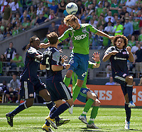 Seattle Sounders FC forward Roger Levesque goes up for a header as he is surrounded by New England Revolution midfielder Shalrie Joseph, left, defender AJ Soares and defender Kevin Alston during play at .CenturyLink Field in Seattle Sunday June 26, 2011. The Sounders won the game 2-1.   during play between the Seattle Sounders FC and the New England Revolution at .CenturyLink Field in Seattle Sunday June 26, 2011. The Sounders won the game 2-1.