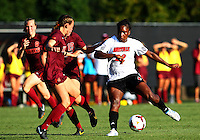 WINSTON-SALEM, NORTH CAROLINA - August 30, 2013:<br />  Christine Exeter (22) of Louisville University moves up onto the defense of Virginia Tech during a match at the Wake Forest Invitational tournament at Wake Forest University on August 30. The game ended in a 1-1 tie.