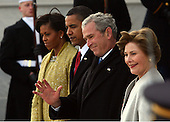 Washington, DC - January 20, 2009 -- United States President Barack Obama and his wife Michelle escort departing former United States President George W. Bush and his wife Laura to a waiting helicopter after the inauguration of Barack Obama as the 44th President of the United States of America, Tuesday, January 20, 2009 in Washington, DC. Obama becomes the first African-American to be elected to the office of President in the history of the United States..Credit: John Moore / Pool via CNP
