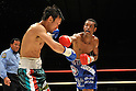 (L-R) Satoshi Hosono (JPN), Celestino Caballero (PAN), DECEMBER 31, 2011 - Boxing : Celestino Caballero of Panama in action against Satoshi Hosono of Japan during the WBA featherweight title bout at Yokohama Cultural Gymnasium in Kanagawa, Japan. (Photo by Hiroaki Yamaguchi/AFLO)
