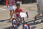William Anderson rides a bike in the 4th of July parade in Oxford, Miss. on Monday, July 4, 2011.
