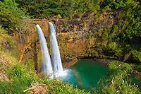 Wailua Falls with a partial rainbow on the island of Kaua'i.