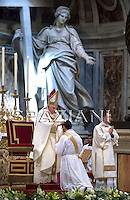 Pope Benedict XVI touches the head to ordain a new priest, inside St. Peter's Basilica, at the Vatican, Sunday, May 3, 2009.