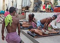 Famous Oil Massage at Babu Ghat, Kolkata, India
