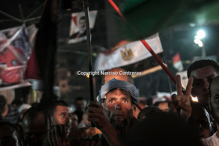 In this Friday, Aug. 02, 2013 photo, a supporter of the ousted president Mohammed Morsi stands during a demonstration in the Al-Rabaa Alawya sit-in at the Nasr City neighbourhood of Cairo. (Photo/Narciso Contreras).