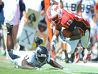 WR Kerry Boykins of the Terrapins hits the ground after getting tripped up from behind.  Maryland defeated FIU 42-28 during a game at Capital One Field at Byrd Stadium in College Park, MD on Saturday, September 25, 2010. Alan P. Santos/DC Sports Box