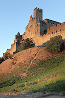 Square Pinte Tower at twilight, Citadel of Carcassonne, Aude, France. Carcassonne was a stronghold of Occitan Cathars during the Albigensian Crusades but was captured by Simon de Montfort in 1209. He added extra fortifications and Carcassonne became a citadel on the French border with Aragon. The fortress restored in 1853 by Eugene Viollet-le-Duc. Today it is a UNESCO World Heritage site. Picture by Manuel Cohen
