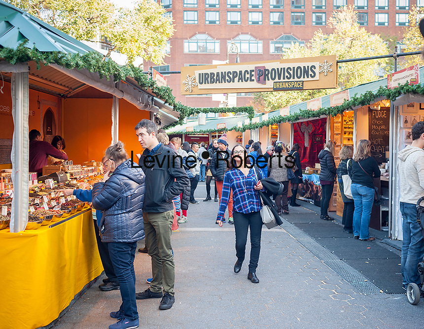 "Shoppers browse the Union Square Holiday Market in New York on opening day, Thursday, November 17, 2016. Over 100 vendors sell their holiday wares at the market which includes ""Lil' Brooklyn"" and ""UrbanSpace Provisions"" sections. Now in it's 23rd year, the market will remain open daily, closing on December 24.  (© Richard B. Levine)"