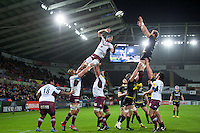 Alun Wyn Jones of the Ospreys rises high to win lineout ball. European Rugby Champions Cup match, between the Ospreys and Bordeaux Begles on December 12, 2015 at the Liberty Stadium in Swansea, Wales. Photo by: Patrick Khachfe / JMP
