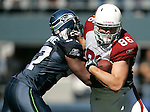 Seattle Seahawks linebacker  David Hawthorne wraps us Arizona Cardinals tight end Todd Heap at CenturyLink Field in Seattle, Washington September 25, 2011.  The Seahawks beat the Cardinals 13-10.  ©2011 Jim Bryant Photo. All Rights Reserved.
