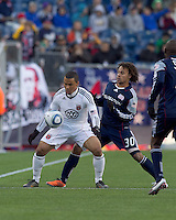 DC United forward Charlie Davies (9) attempts to control the ball as New England Revolution defender Kevin Alston (30) defends. In a Major League Soccer (MLS) match, the New England Revolution defeated DC United, 2-1, at Gillette Stadium on March 26, 2011.