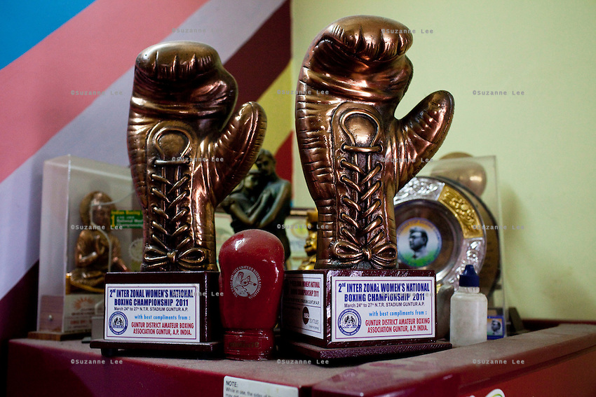 Razia Shabnam's many accolades decorate her fridge and home in Ekbalpore, Calcutta, West Bengal, India. Razia Shabnam, 28, was one of the first women boxers in Kolkata. She was also the first woman in her community to go to college. She is now a coach and one of only three international female boxing referees in India.  Photo by Suzanne Lee for Panos London