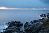 Rocky coastline and waters of Vestfjord, Moskenesoy, Lofoten Islands, Norway