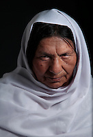 The only known female Mujahideen commander, Kaftar, was once the leader of a 600-strong armed force. Today she can&rsquo;t even leave the safe house where she is staying as a guest along with her granddaughter. Her enemies, mostly from the neighboring village, are looking for her to settle an old score. According to local accounts, her husband failed to avenge the murder of a relative &ndash; Bibi, as she is called by her eight children, took matters into her own hands and soon after enlisted with the Jamiyat-e-Islami forces of Ahmad Shah Massoud&rsquo;s forces at the height of the Soviet invasion of Afghanistan in the early 80&rsquo;s. Born in Bahglan province, Kaftar is proud to have never surrendered to the Taliban &ndash; in fact, her area of operations never fell to the militants onslaught. Like many other Jihadi commanders, Kaftar surrendered her weapons as part of the UN Disbandment of Illegal Armed Groups program (DIAG) &ndash; however, she kept some small arms for herself and her personal guards. One of these weapons is her Russian-made Makarov pistol, which she always carries on a holster under her shoulder. <br /> Like many other warlords (and former Mujahideen) in Afghanistan, Kaftar used the power of the gun for extortion and self-enrichment. Several residents of her native village of Khoza claim that she is responsible for at least ten deaths along with demanding tax money and extortion from the locals in order to fund her operations. Like many other warlords in Afghanistan, the central and local governments have not made any effort to bring her to justice.