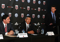 WASHINGTON, DC-JULY 10,2012:  Doug Hicks of DC United looks down on Jason Levien and Will Chang during a D.C. United ownership press conference at the POV Lounge in the W Hotel, Washington, DC.