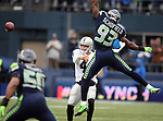 Oakland Raiders quarterback Derek Carr (4) passes while under pressure from Seattle Seahawks defensive end O'Brien Schofield (93) at CenturyLink Field in Seattle, Washington on November 2, 2014. The Seahawks beat the Raiders 30-24 in Seattle. ©2014. Jim Bryant Photo.
