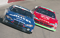 Pole-sitter Ryan Newman (blue car) battles for the lead with Jeremy Mayfield early in the Pop Secret 400 NASCAR Winston Cup race at Rockingham, NC on Sunday, November 9, 2003. (Photo by Brian Cleary)