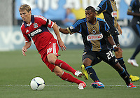 CHESTER, PA - AUGUST 12, 2012:  Raymon Gaddis (28) of the Philadelphia Union chases Chris Rolfe (18) of the Chicago Fire during an MLS match at PPL Park, in Chester, PA on August 12. Fire won 3-1.