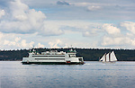 The WA ferry passes the schooner Adventuress, off of Port Townsend.