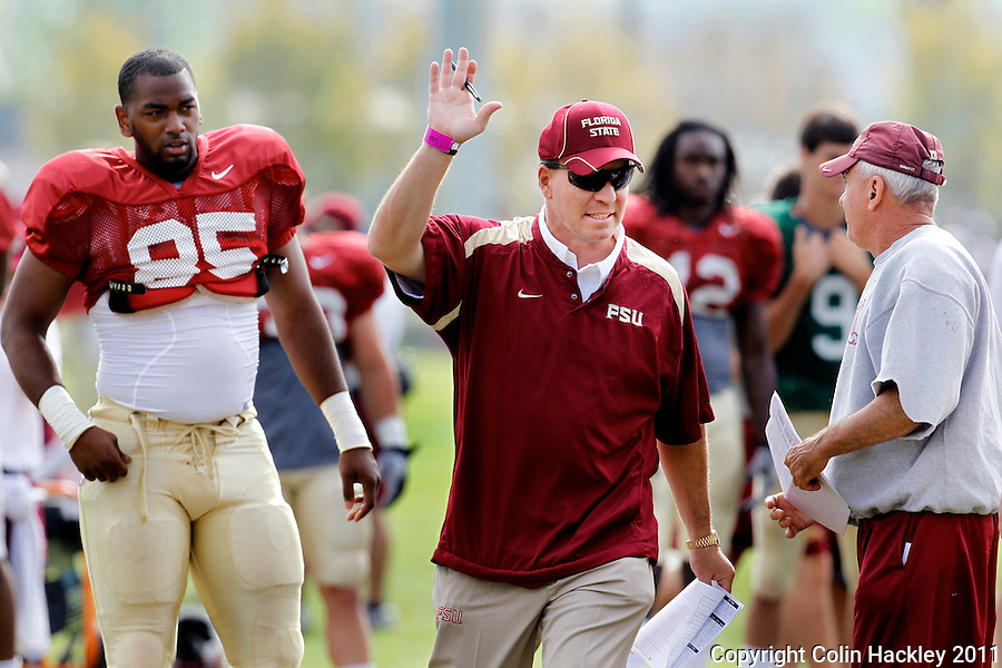 TALLAHASSEE, FLA. 3/26/11-FSU032611 CH-Florida State Head Coach Jimbo Fisher, center, and Offensive Line Coach Rick Trickett direct during practice Saturday in Tallahassee..COLIN HACKLEY PHOTO