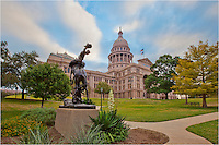 This morning photograph shows the Texas Cowboy monument on the grounds of the Texas State Capitol building in Austin.