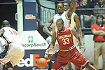 "Arkansas' Marshawn Powell (33) vs. Ole Miss' Murphy Holloway (31) at the C.M. ""Tad"" Smith Coliseum in Oxford, Miss. on Saturday, January 19, 2013. Mississippi won 76-64. (AP Photo/Oxford Eagle, Bruce Newman)"