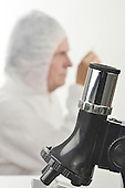 Stock photo of scientist and microscope