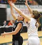 Chugiak's Hannah Russell shoots against Ketchikan's Brittany Slick in the state basketball tournament.   Photo for the Star by  Michael Dinneen